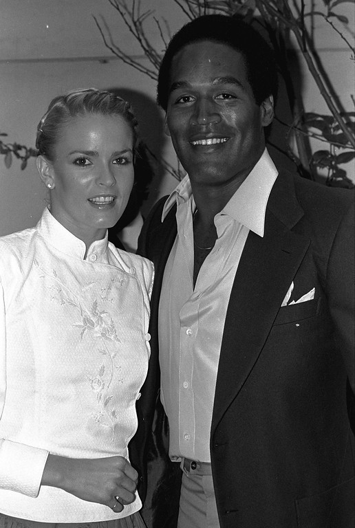 """. Former football star O.J. Simpson and friend Nicole Brown get together at party Monday night, May 6, 1980 in Beverly Hills section of Los Angeles.  The couple attended introduction party for a new geometric puzzle invented in Hungary and being distributed here as \""""Rubik\'s Cube.\""""  (AP Photo/Nick Ut)"""