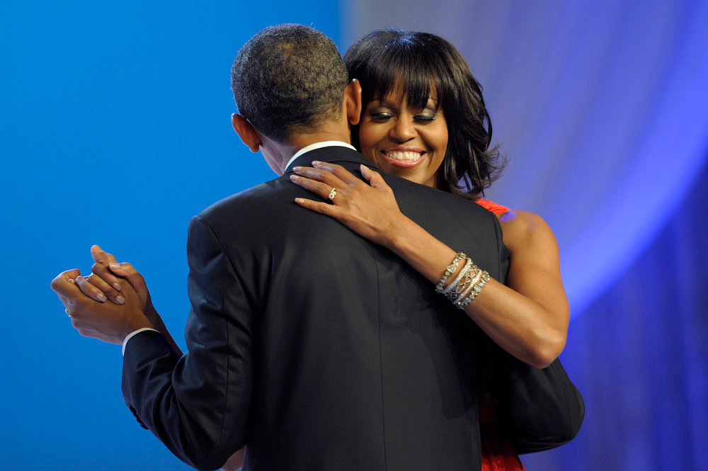 Description of . First lady Michelle Obama smiles has she dances with President Barack Obama during The Inaugural Ball at the Washignton convention center during the 57th Presidential Inauguration in Washington, Monday, Jan. 21, 2013. (AP Photo/Cliff Owen)