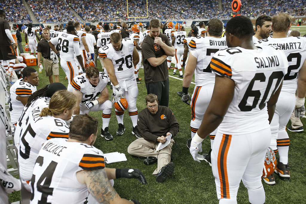 . Cleveland Browns offensive line coach Andy Moeller talks with the line against the Detroit Lions in the second half of a preseason NFL football game at Ford Field in Detroit, Saturday, Aug. 9, 2014.  (AP Photo/Duane Burleson)