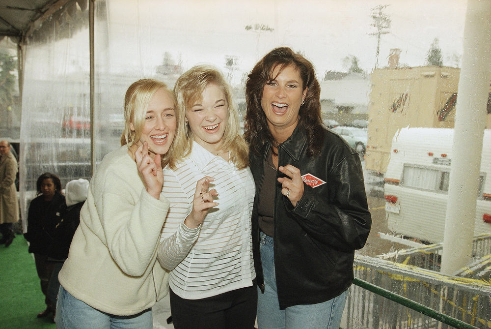 Description of . In this Jan. 26, 1997 file photo, country music singers Mindy McCready, left, LeAnn Rimes and Terri Clark joke around after a rehearsal for the American Music Awards at the Shrine Auditorium in Los Angeles. McCready, who hit the top of the country charts before personal problems sidetracked her career, died Sunday, Feb. 17, 2013. She was 37. (AP Photo/Michael Caulfield, File)