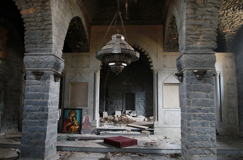 . This photograph made on a military-led media tour shows damage inside the Um al-Zinar church in the old city of Homs, Syria on Friday, May 9,  2014, where bulldozers cleared rubble from the streets of battle-scarred districts in the central Syrian city after government troops entered the last rebel-held neighborhoods as part of an agreement that also granted opposition fighters safe exit from the city. (AP Photo)