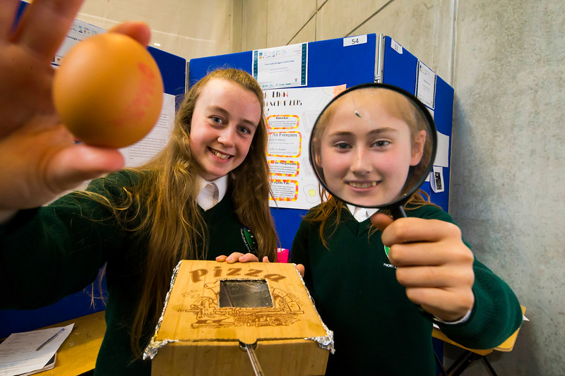"""01/05/2018. SciFest at WIT (Waterford Institute of Technology) at the Arena. Pictured are Cadhla  Ni Rian and Sasha Ni Dhhnuin from Ghaelcholaiste Phort Lairge with their project """"Can I Cook An Egg In A Pizza Box"""". Picture: Patrick Browne"""