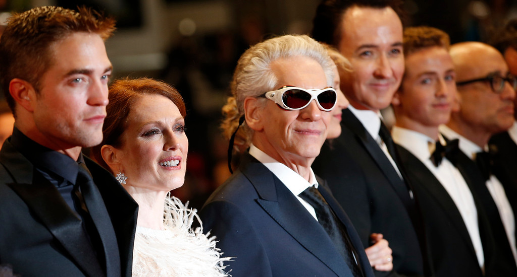 . From left, actor Rob Pattinson, actress Julianne Moore, director David Cronenberg, actor John Cusack, actor Evan Bird and screenwriter Bruce Wagner pose for photographers as they arrive for the screening of Maps to the Stars at the 67th international film festival, Cannes, southern France, Monday, May 19, 2014. (AP Photo/Alastair Grant)