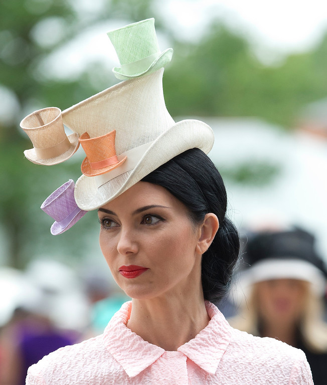 . Olga Stepanenko  walks in the parade ring on the third day of the Royal Ascot horse racing meeting, which is traditionally known as Ladies Day, at Ascot, England,  Thursday, June, 19, 2014.  Royal Ascot the annual five day horse race meeting that Britain\'s Queen Elizabeth II attends every day of the event. (AP Photo/Alastair Grant)