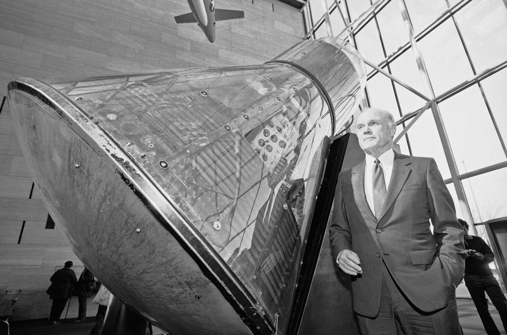 . Sen. John Glenn, D-Ohio, stands next to the Mercury Spacecraft Friendship 7 that he orbited the earth in 20 years ago, Feb. 20, 1982, Washington, D.C. Glenn celebrated the anniversary at the Smithsonians Air and Space Museum where the space craft is on display. Glenn was the third U.S. astronaut in space but the first to orbit the earth. (AP Photo/Scott Applewhite)