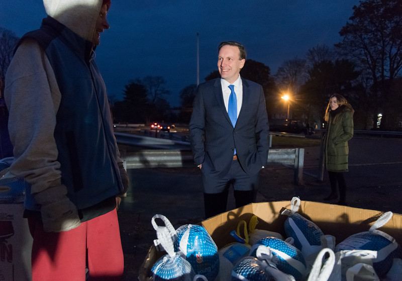 11/20/17  Wesley Bunnell | Staff  HRA held its annual turkey distribution at the New Britain Food & Resource Center on Monday afternoon with help from workers and volunteers. Senator Chris Murphy chats with HRA employee and food drive volunteer Bob Garey as they stand in front of a large box of frozen turkeys.