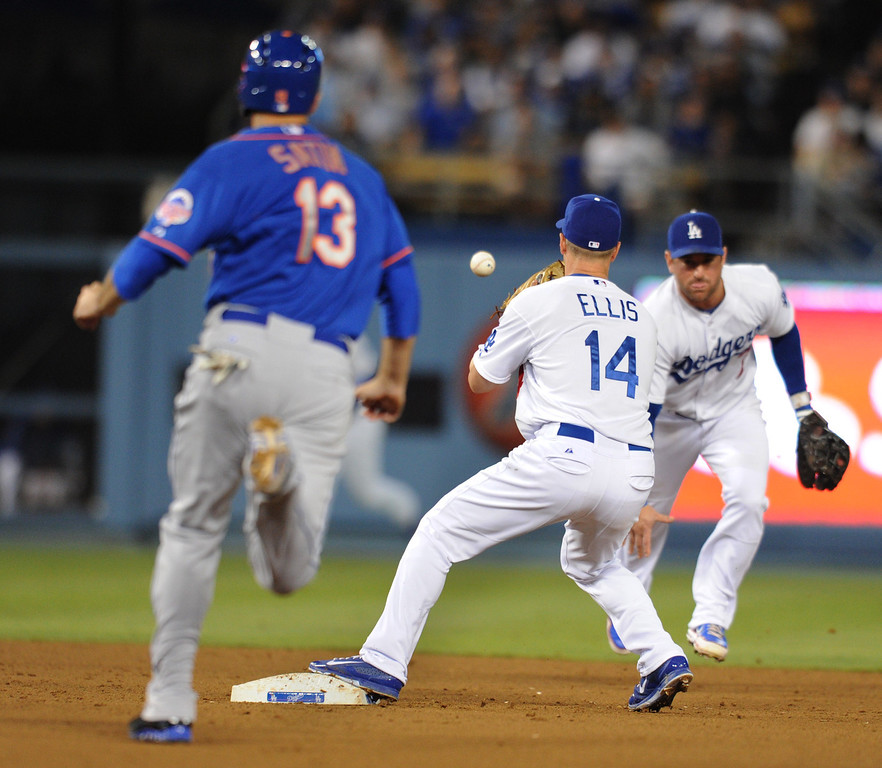 . Nick Punto flips the ball to Mark Elllis to catch Mets #13 Josh Satin at 2nd base. The Dodgers played the New York Mets in a game at Dodger Stadium in Los Angeles, CA. 8/13/2013(John McCoy/LA Daily News)