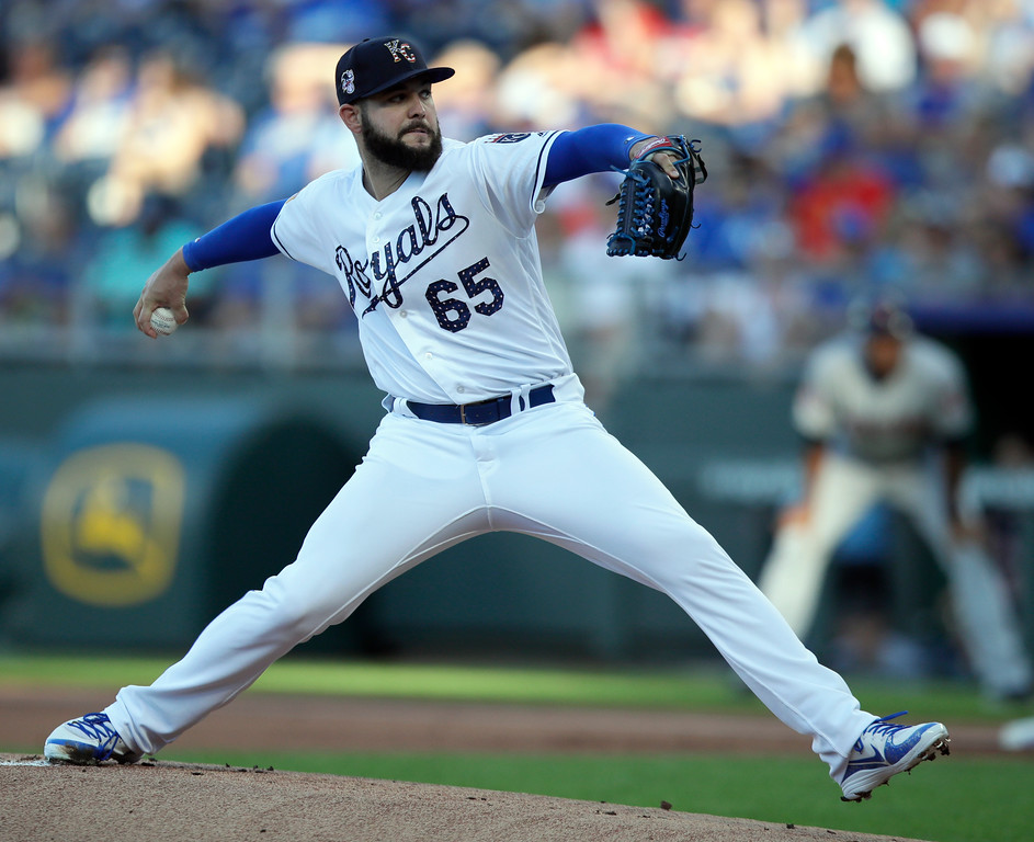 . Kansas City Royals starting pitcher Jakob Junis delivers to a Cleveland Indians batter during the first inning of a baseball game at Kauffman Stadium in Kansas City, Mo., Monday, July 2, 2018. (AP Photo/Orlin Wagner)