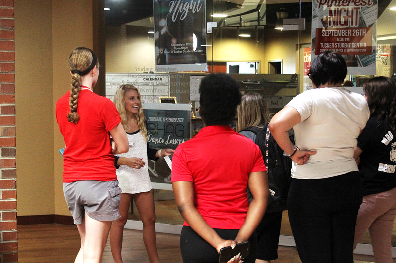 Gardner Webb student Sara Marconi stops to tell possible future freshman about student activities on their tour of campus.