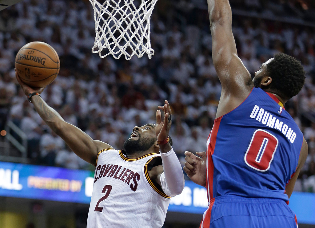 . Cleveland Cavaliers\' Kyrie Irving (2) drives to the basket against Detroit Pistons\' Andre Drummond (0) in the first half in Game 1 of a first-round NBA basketball playoff series, Sunday, April 17, 2016, in Cleveland. The Cavaliers won 106-101. (AP Photo/Tony Dejak)