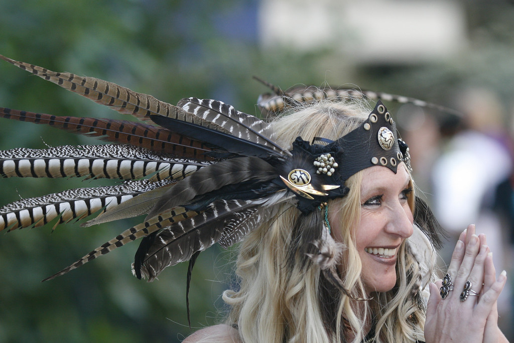 . DENVER, COLORADO - JUNE 1: A dancer displays a headdress and poses for photos with Denver Comic Con patrons outside the Convention Center on Saturday, June 1, 2013. The Denver Comic Con is at the Colorado Convention Center May 31 through June 2, 2013. (Photo by Daniel J. Schneider/The Denver Post)