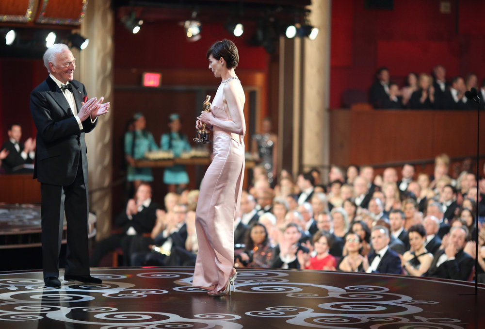 Description of . Actress Anne Hathaway accepts the Best Supporting Actress award for