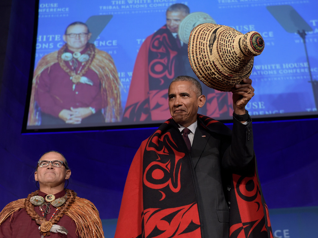. President Barack Obama tips he hat as he stands with Brian Cladoosby, President of National Congress of American Indians, at the 2016 White House Tribal Nations Conference, Monday, Sept. 26, 2016, at the Mellon Auditorium in Washington.(AP Photo/Susan Walsh)