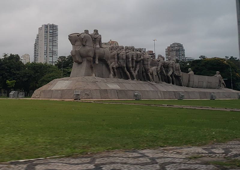 "Statue near Ibirapuera Park in Sao Paulo - has brazilian nickname ""da uma empurradinha ai"". Rough translation: ""let me give you a hand."""