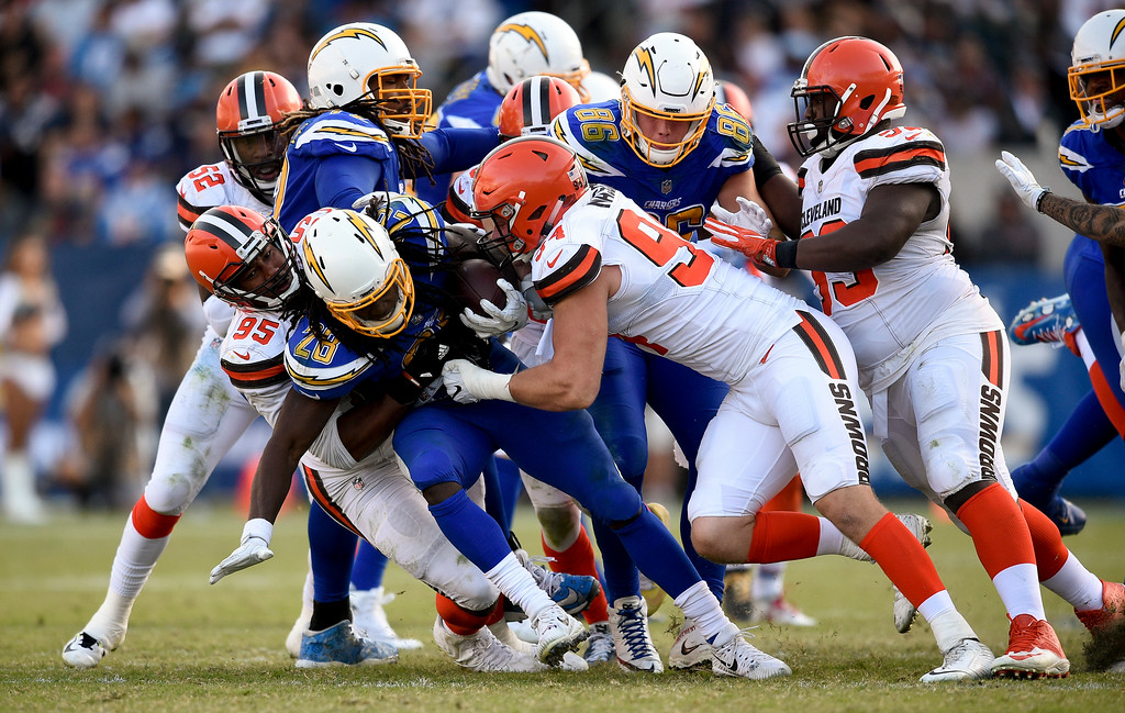 . Los Angeles Chargers running back Melvin Gordon is tackled by the Cleveland Browns during the second half of an NFL football game Sunday, Dec. 3, 2017, in Carson, Calif. (AP Photo/Kelvin Kuo)