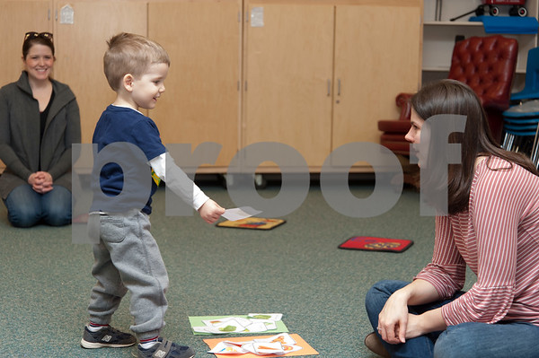 01/24/18 Wesley Bunnell | Staff Registered Dietitian Katie Shepherd brought her Food Explorers program to the Bristol Public Library on Wednesday morning to work with a group of pre school age children. The program teaches healthy food choices through sensory experiences and activities followed with hands on food exploration. Shepherd, R, helps Zachary D'Innocenzo place the foods in the correct group as mom Kate D'Innocenzo looks on.