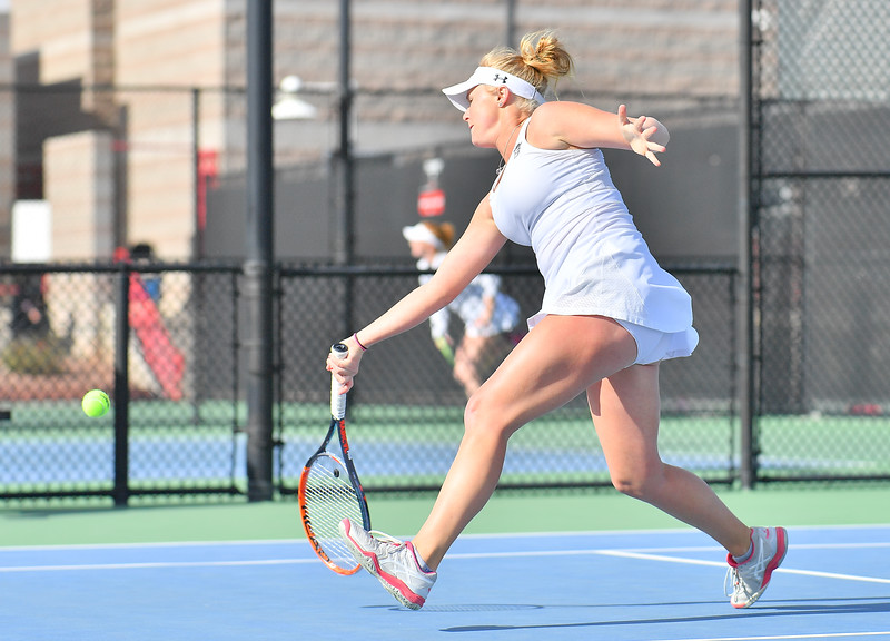 LAS VEGAS, NV - JANUARY 20:  Lindsay Harlas of the New Mexico State Aggies plays a forehand during her match against Tereza Pilzova of the Weber State Wildcats at the Frank and Vicki Fertitta Tennis Complex in Las Vegas, Nevada. Harlas won the match 4-6, 7-5, 1-0 (10-5).