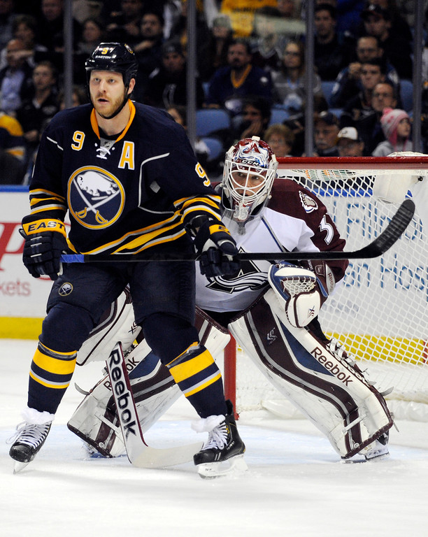 . Buffalo Sabres center Steve Ott (9) screens Colorado Avalanche goaltender Jean-Sebastien Giguere (35) during the first period of an NHL hockey game in Buffalo, N.Y., Saturday, Oct. 19, 2013. (AP Photo/Gary Wiepert)