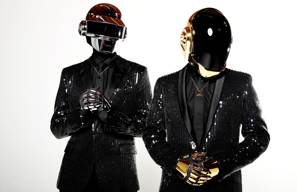 . FILE - In this April 17, 2013 file photo, Thomas Bangalter, left, and Guy-Manuel de Homem-Christo, from the music group, Daft Punk, pose for a portrait in Los Angeles. Daft Punk has five nominations at Sunday, Jan. 26, 2014 Grammy Awards, including album of the year for ìRandom Access Memoriesî and record of the year for ìGet Lucky.î  (Photo by Matt Sayles/Invision/AP, File)