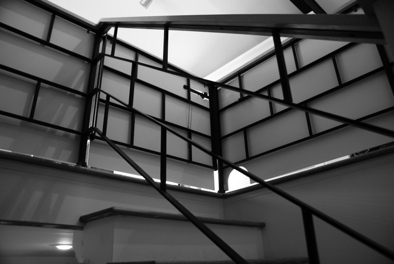 Stairangles: This is a shot of the staircase in my brother's house. The hand rail creates a smörgåsbord of interesting geometric shapes from this perspective.