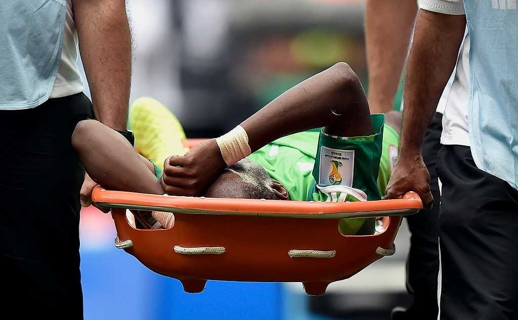 . Nigeria\'s Ogenyi Onazi is carried from the pitch after getting  injured during the World Cup round of 16 soccer match between France and Nigeria at the Estadio Nacional in Brasilia, Brazil, Monday, June 30, 2014. (AP Photo/Martin Meissner)