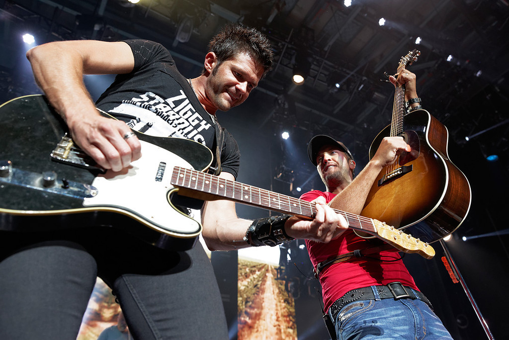 . Luke Bryan (right) performs June 18, 2014, in the first of two concerts at DTE Energy Music Theatre. Photo by Ken Settle