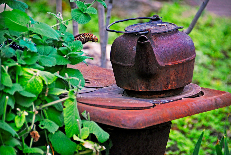 2011/9/13 – I don't know what to say about this one, other than I love the rusted cast iron contrasted against the lush green foliage. It is an old wood burning stove with a tea pot from the same era. This looks like something someone abandoned, but is actually part of the landscape around an old miners cabin in the Provo area. It's at Almosta Ranch that I shot the red star wagon bench at on september 9th – http://bit.ly/nLUmRO