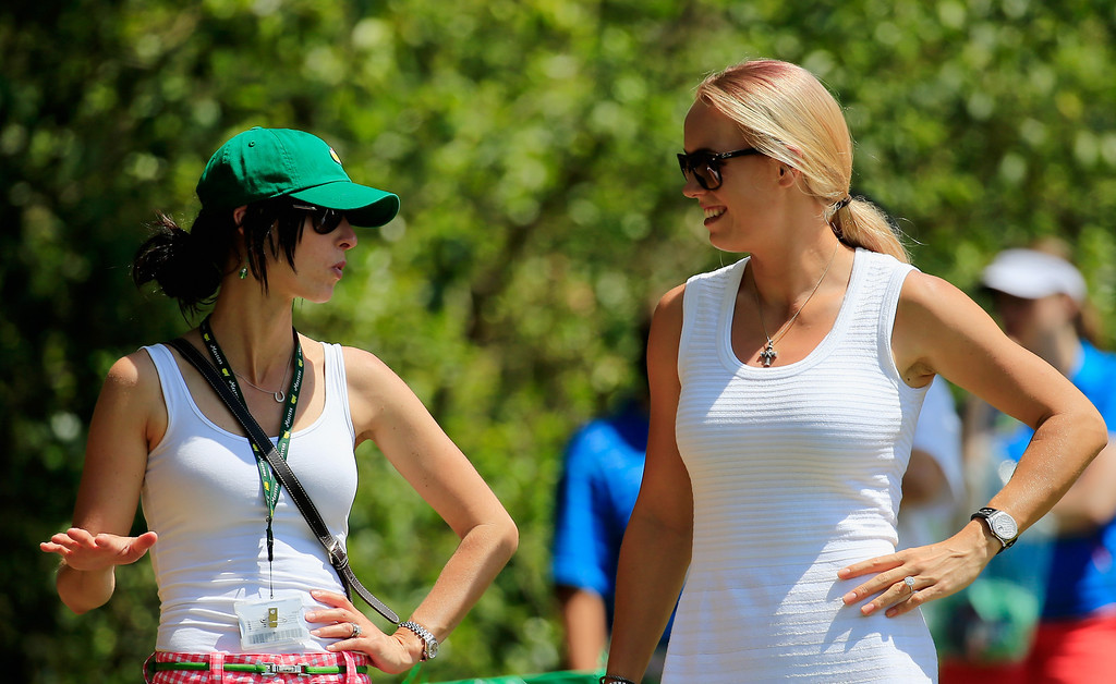 . Tennis player Caroline Wozniacki (R) watches the play of Rory McIlroy during the final round of the 2014 Masters Tournament at Augusta National Golf Club on April 13, 2014 in Augusta, Georgia.  (Photo by Rob Carr/Getty Images)