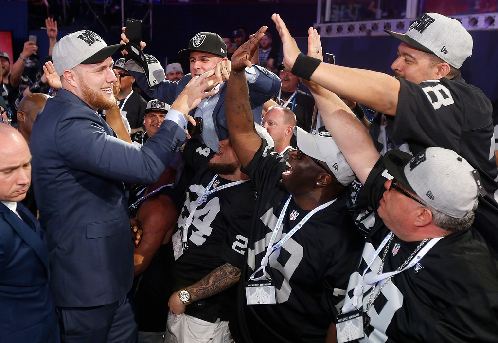 . UCLA\'s Kolton Miller celebrates with fans after being selected by the Oakland Raiders during the first round of the NFL football draft, Thursday, April 26, 2018, in Arlington, Texas. (AP Photo/Michael Ainsworth)