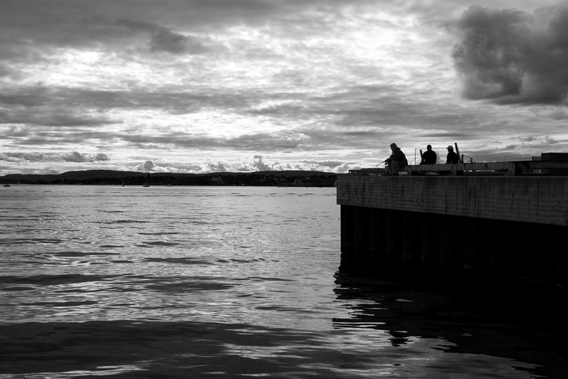 Fishing is a national passion in Norway, as well as one of the more traditional economical activities. Dramatic B&W image with stormy sky.