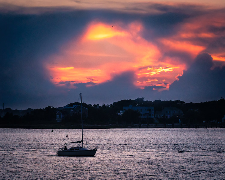 """""""Valentine Sunset"""" - a """"heart-shaped"""" opening in the dark storm clouds revealed a dramatic red sunset behind them. Cape Cod, Mass"""