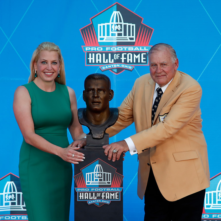 . Former NFL player Jerry Kramer, right, poses with a bust of himself and presenter, daughter Alicia Kramer, during an induction ceremony at the Pro Football Hall of Fame, Saturday, Aug. 4, 2018 in Canton, Ohio. (AP Photo/Gene J. Puskar)