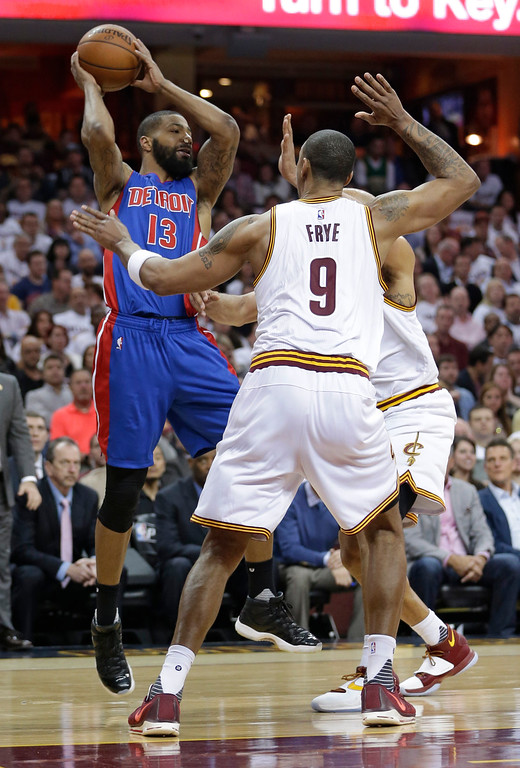 . Detroit Pistons\' Marcus Morris (13) passes against the Cleveland Cavaliers in the second half in Game 2 of a first-round NBA basketball playoff series, Wednesday, April 20, 2016, in Cleveland. (AP Photo/Tony Dejak)