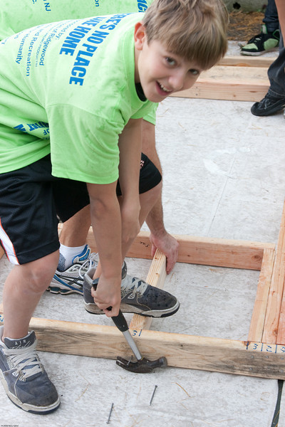 (1) Pslip Slug #: W 25054; (2) Ridgewood, NJ; (3) 10/24/09; (4) Habitat for Humanity Builds a House for Make a Difference Day on 10/24/2009; (5)  Andrew Mulard keeps track of details as a Habitat for Humanity Volunteer during Ridgewood's Make A Difference Day on 10/24/2009; (6) W.H. Grae for the Ridgewood News.