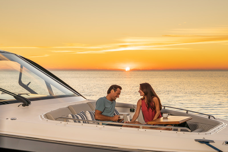 2021-Sundancer-370-Outboard-DAO370-lifestyle-bow-couple-table-sunset-05895.jpg