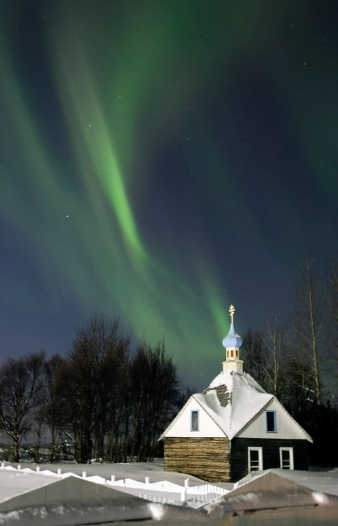 . The northern lights or aurora borealis fill the western sky Friday, March 9, 2012, above the Russian Orthodox Saint Nicholas Memorial Chapel in Kenai, Alaska. The display of lights came in the aftermath of a solar storm that struck Earth on Thursday.  (AP Photo/Peninsula Clarion, M. Scott Moon)