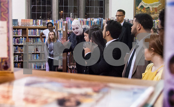 03/08/18 Wesley Bunnell | Staff New Britain High School had a rehearsal for the upcoming The Addams Family , A New Musical Comedy, on Thursday night at The New Britain Public Library. Looking through the stack of books Robert Breau as Uncle Fester waves to Maeve Maltese playing Morticia Addams.