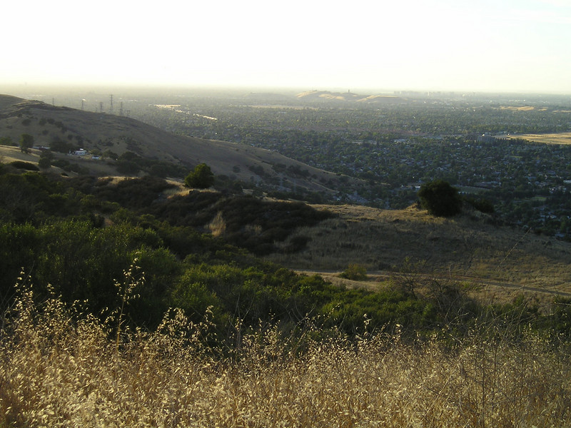Looking off to the northwest, I can see the big empty area that'll someday be Martial Cottle Park, directly behind my house (top center, below horizon, light colored area).