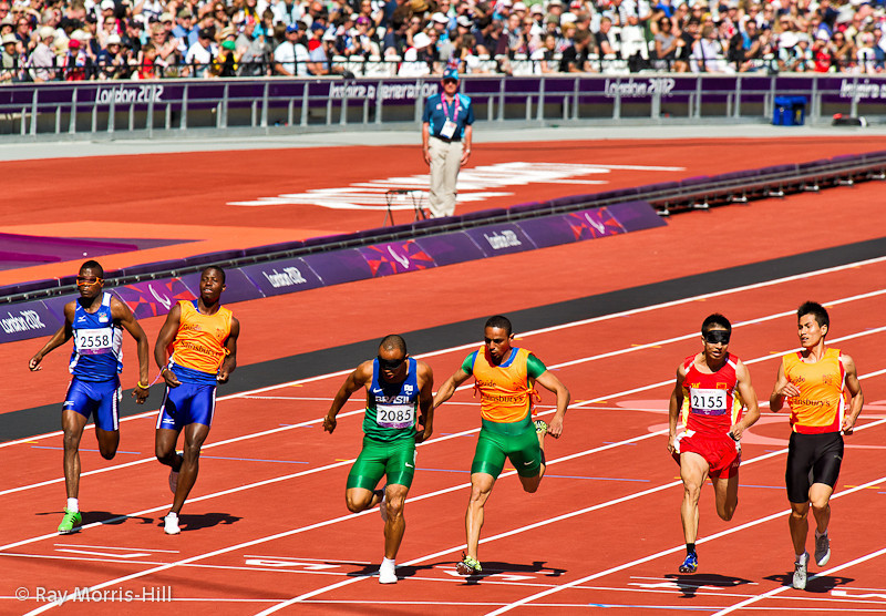 Athletics action in the Olympic Stadium, 8 September, 2012.  Gomez Felipe of Brazil wins a tight Men's 100m T11  semi-final.  He was guided by Justino Barbosa dos Santos and won Silver in the final.