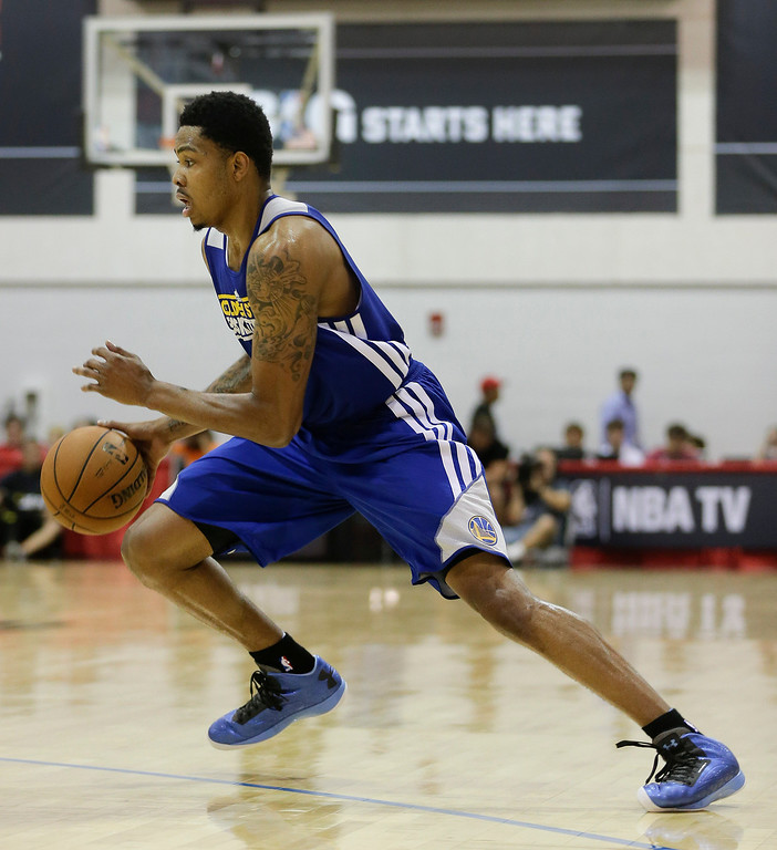 . Golden State Warriors Kent Bazemore drives against the Washington Wizards in the third quarter of an NBA Summer League basketball game, Saturday, July 13, 2013, in Las Vegas. (AP Photo/Julie Jacobson)