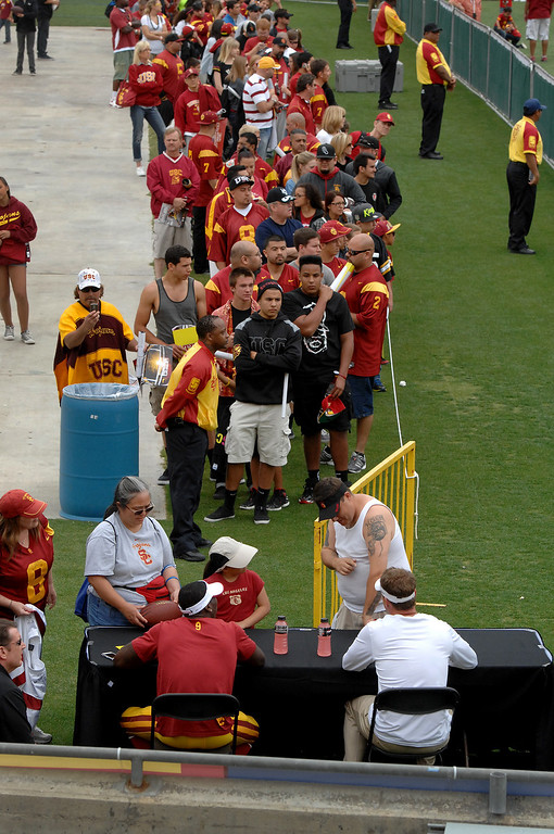 . Fans wait in line for autographs from Marqise Lee and head coach Lane Kiffin following USC\'s Spring Football Game. (Michael Owen Baker/Staff Photographer)