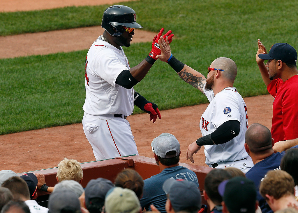. David Ortiz #34 of the Boston Red Sox celebrates with Jonny Gomes after scoring in the 1st inning at Fenway Park on June 26, 2013 in Boston, Massachusetts.  (Photo by Jim Rogash/Getty Images)