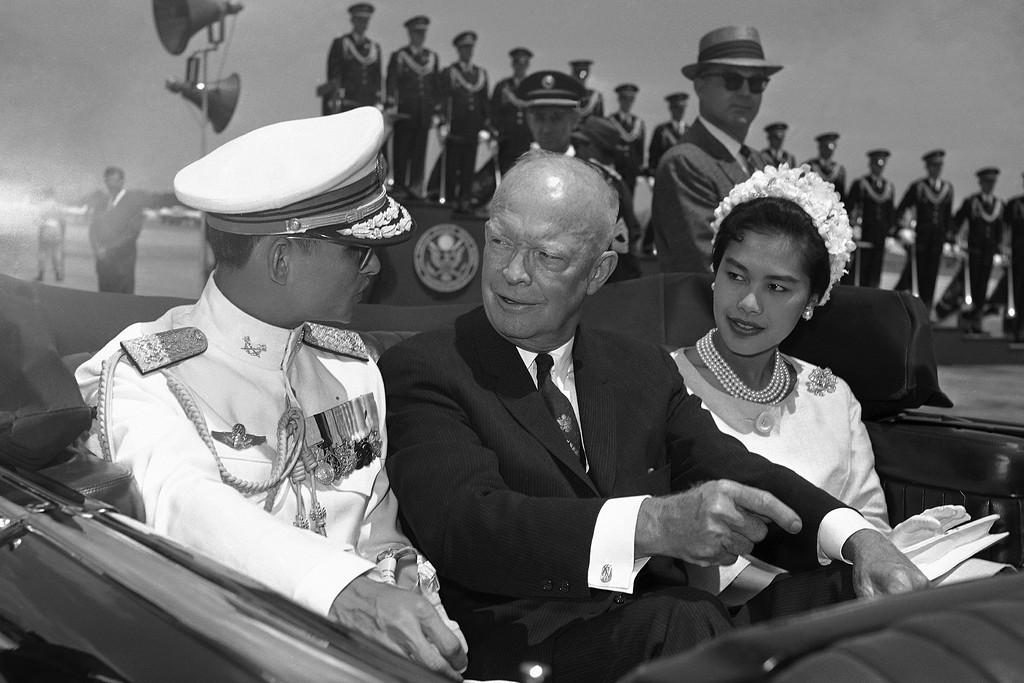 . In this June 28, 1960, file photo, U.S. President Dwight Eisenhower, center, is seated between Thailand\'s King Bhumibol Adulyadej, left, and Queen Sirikit for a motorcade drive from National Airport to the White House in Washington. Thailand\'s Royal Palace said on Thursday, Oct. 13, 2016, that Thailand\'s King Bhumibol Adulyadej, the world\'s longest-reigning monarch, has died at age 88. (AP Photo, File)