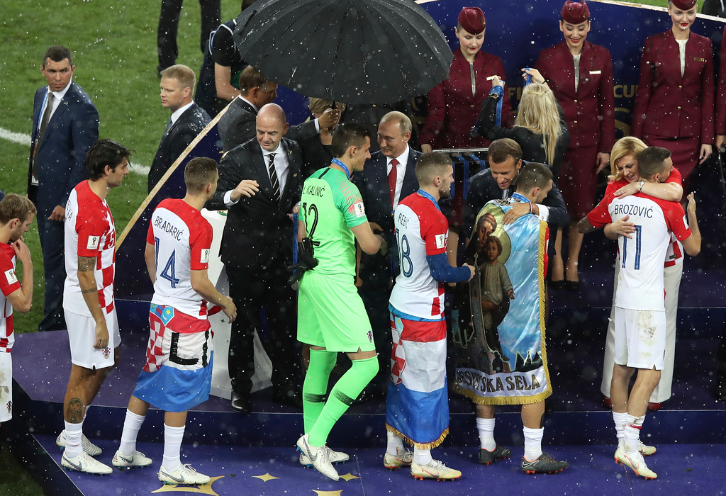 . Croatian President Kalinda Grabar-Kitarovic hugs Croatia\'s Marcelo Brozovic, right, at the end of the final match between France and Croatia at the 2018 soccer World Cup in the Luzhniki Stadium in Moscow, Russia, Sunday, July 15, 2018. (AP Photo/Thanassis Stavrakis)