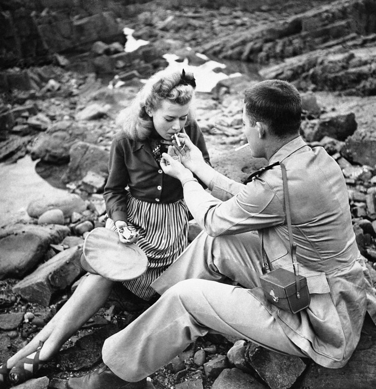 . An American cigarette on the shore at Sidi Abd-er-Rahman, a few miles south of Casablanca on Jan. 23, 1943, tops off a picnic lunch of canned, sardines, boiled eggs, toast, oranges and wine a fitting climax to an enjoyable day for a couple of strangers. (AP Photo)