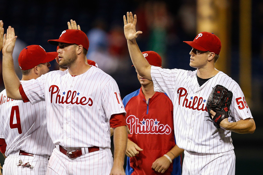 . Jonathan Papelbon #58 of the Philadelphia Phillies is congratulated by teammates on the field after the game against the Colorado Rockies  at Citizens Bank Park on August 19, 2013 in Philadelphia, Pennsylvania. The Phillies won 5-4. (Photo by Brian Garfinkel/Getty Images)