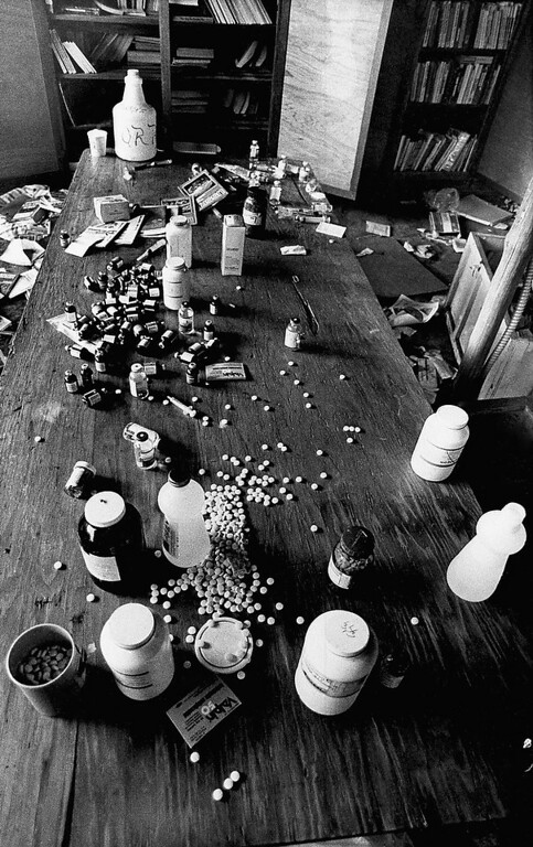 . Various drugs are scattered along a table at a cult site, on Nov. 26, 1978, in Jonestown, Guyana. Investigators uncovered the large quantity of drugs while searching the home of the religious cult for victims of the mass suicide that resulted in more than 900 deaths. (AP Photo/Val Mazzenga)