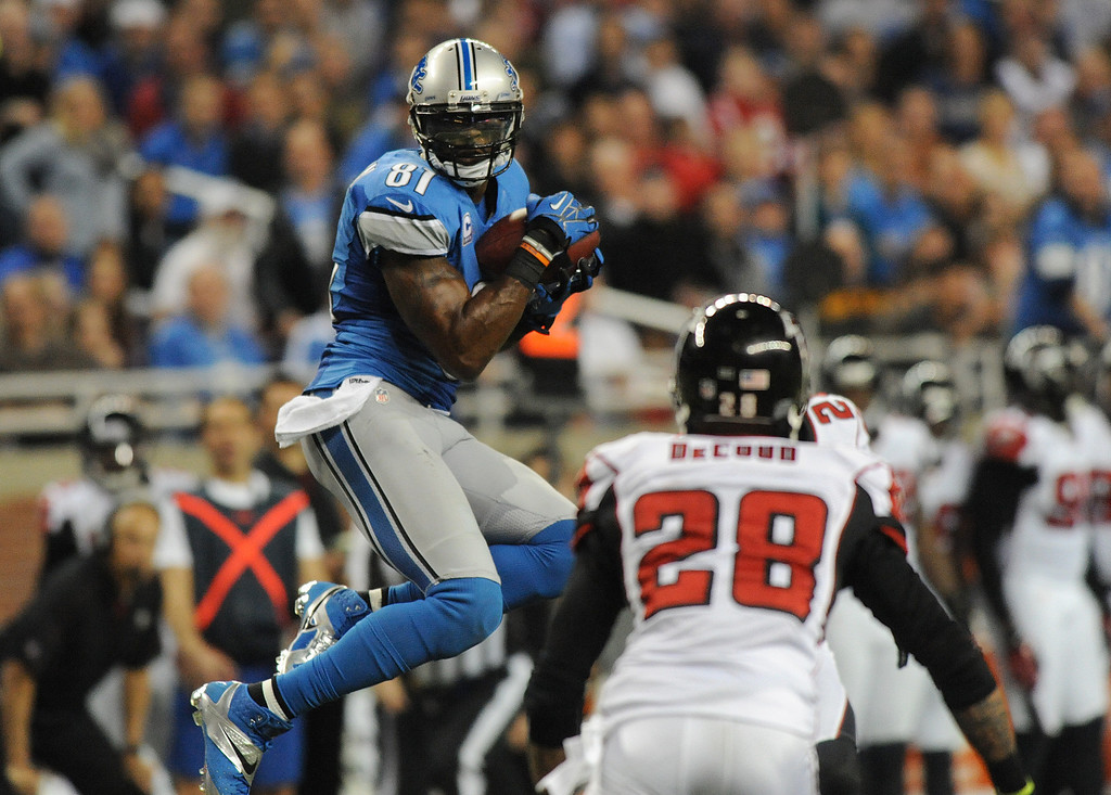 . Detroit Lions wide receiver Calvin Johnson (81) hauls in a pass for 21 yards in the third quarter against the Atlanta Falcons.  The Falcons beat the Lions, 31-18.  Photo taken on Saturday, December 22, 2012, at Ford Field in Detroit, Mich.  (Special to The Oakland Press/Jose Juarez)