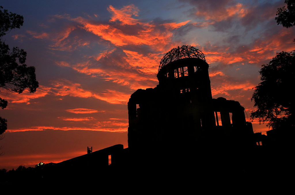 . The Atomic Bomb Dome is silhouetted at sunset in Hiroshima, western Japan,  Monday, Aug. 5, 2013. Hiroshima marks the 68th anniversary of the world\'s first atomic bombing Tuesday.(AP Photo/Shizuo Kambayashi)