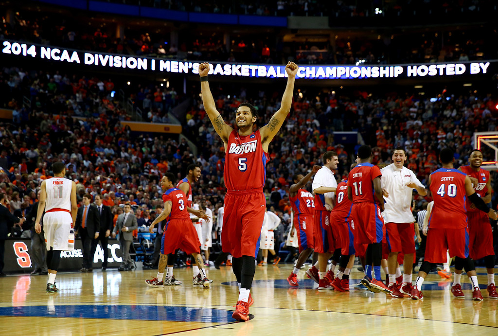 . BUFFALO, NY - MARCH 22: Devin Oliver #5 of the Dayton Flyers reacts after defeating the Syracuse Orange 55-53 in the third round of the 2014 NCAA Men\'s Basketball Tournament at the First Niagara Center on March 22, 2014 in Buffalo, New York.  (Photo by Elsa/Getty Images)